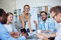 Happy employees around desk