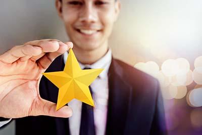 Man holding star